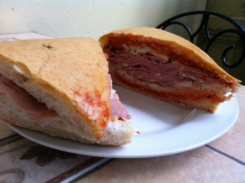A Media Noche sandwich, filled with ham and cheese and some salsa, is a common sight on the streets of Havana